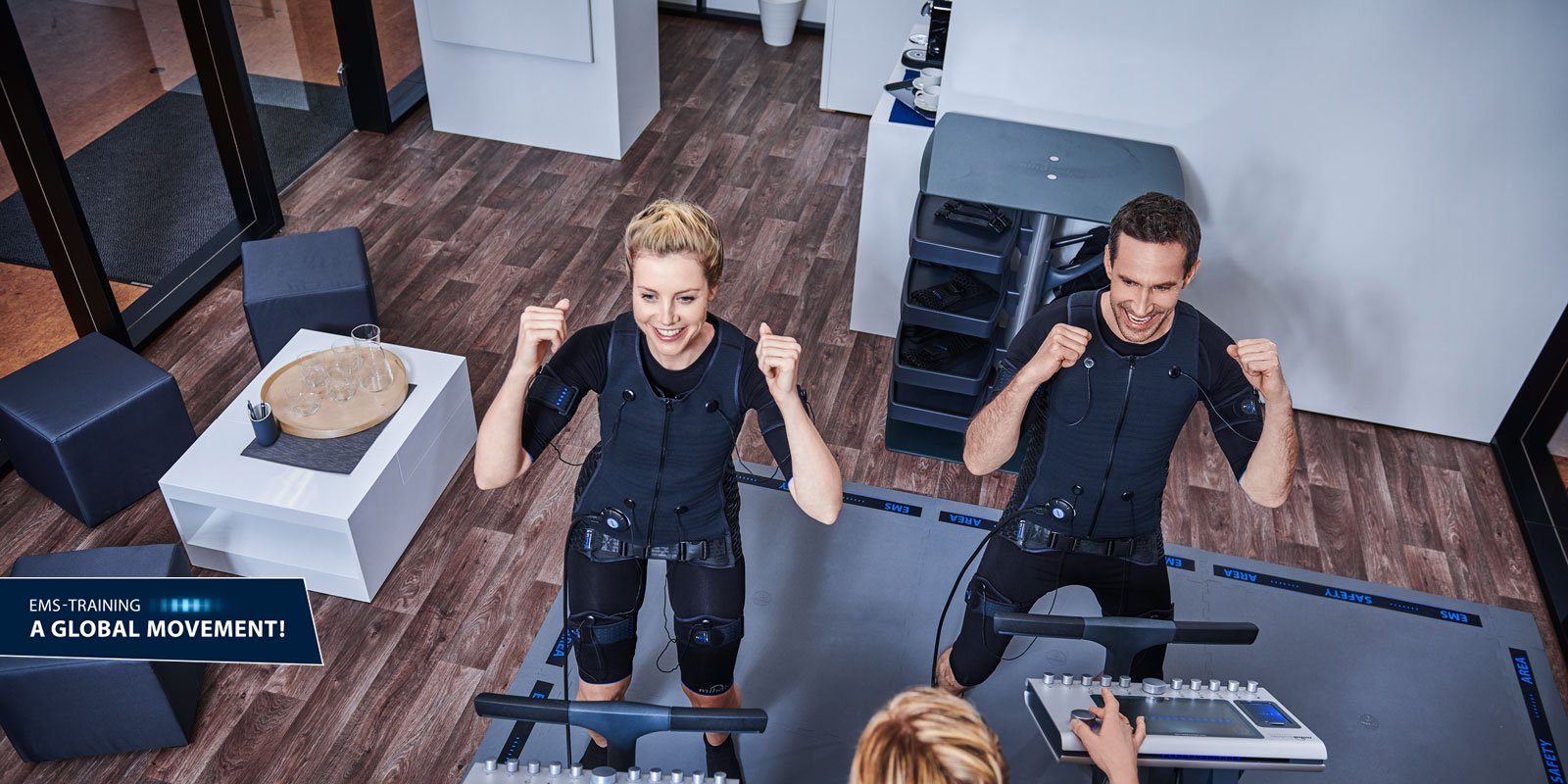 two persons exercising on miha bodytec 2 devices